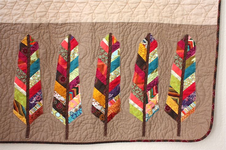 close up, pieced feathers by Raymond K Houston | Nacho Mama's Quilt.  The feathers pattern is by Anna Maria Horner. We love the Southwestern colors.