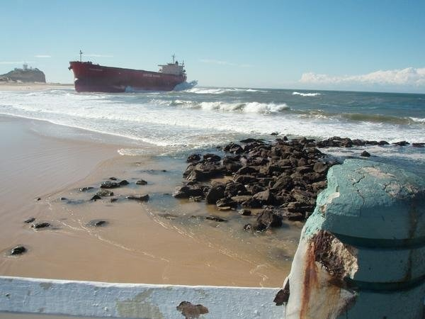 Nobbies Beach, Newcastle, NSW Australia soon after a storm-ship ran aground.