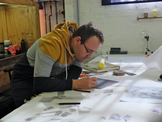 Quinten Williams creating an etching on exhibition at TAF 2014