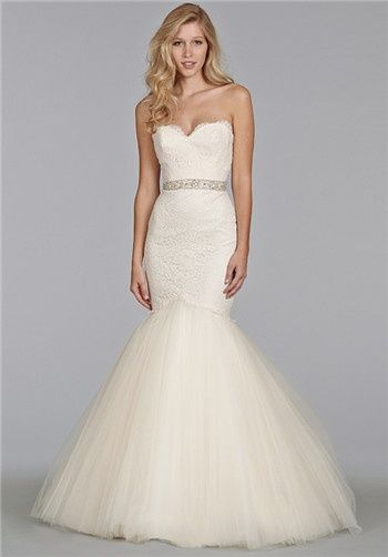 Ivory Alencon lace fit and flare gown, strapless elongated bodice with beaded belt at natural waist, full tulle skirt with chapel train.