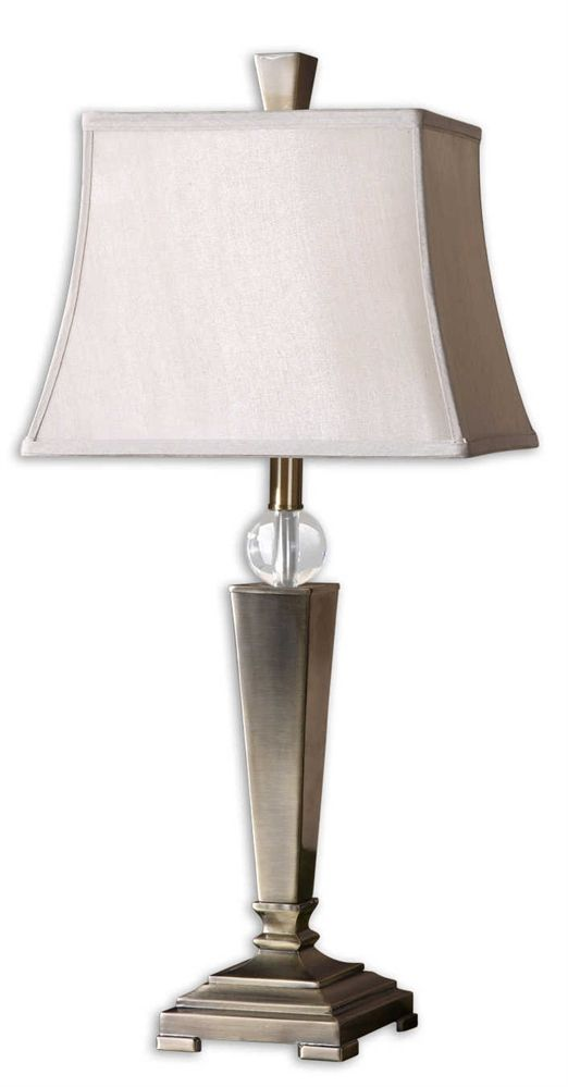 Uttermost - Mantello, 2 Per Box Show Picture 1Show Picture 2   Mantello, 2 Per Box  Download image View tearsheet (clean) View tearsheet (accessorized) « PREV NEXT » Mantello, 2 Per Box Item #26267 Plated coffee bronze metal with a crystal ball accent. The square semi bell shade is a silken champagne fabric. Packed 2 per box but priced individually.  Designer:	NA Wattage/Bulb Type:	100W , ON-OFF # of Bulbs:	1 Dimensions:	29H,   Shade 10H X 13 Dia. (in)