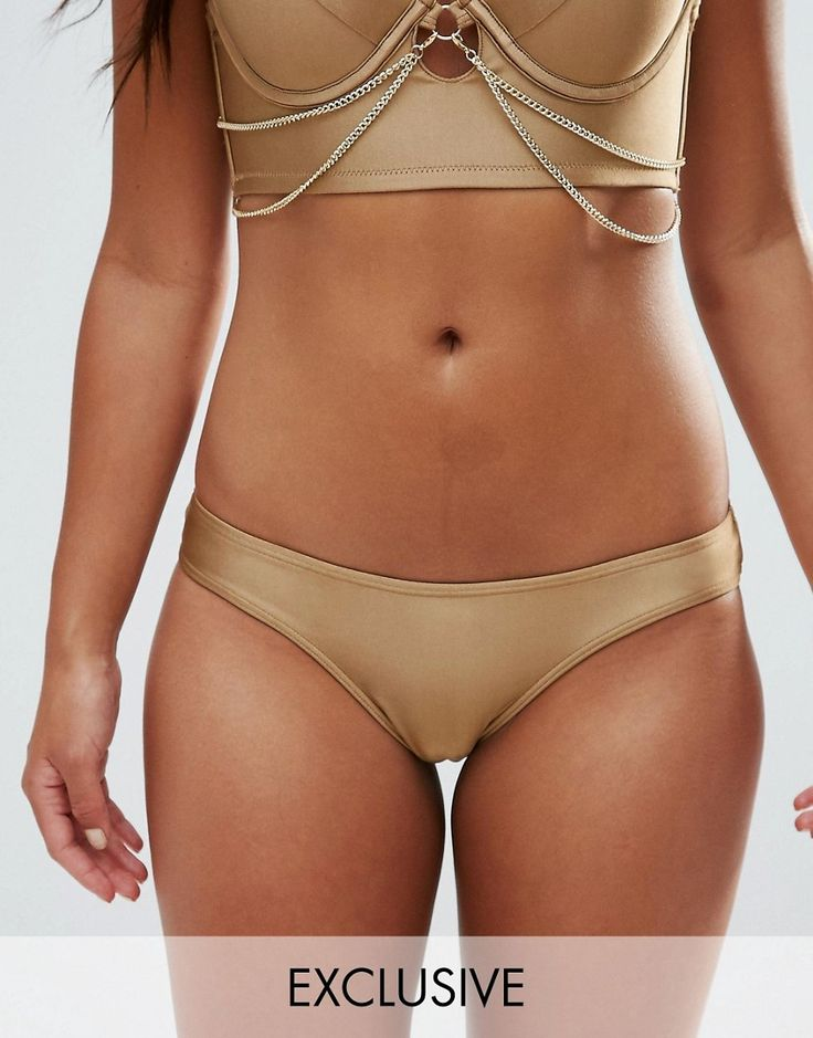 Buy it now. Wolf & Whistle Cheeky Bikini Bottom - Gold. Bikini briefs by Wolf Whistle, Stretch swim fabric, Metallic finish, High-cut leg, Hand wash, 86% Polyester, 14% Elastane, Our model wears a UK 8/EU 36/US 4 and is 164cm/5'4.5 tall, Exclusive to ASOS. ABOUT WOLF WHISTLE Founded in 2012, London label Wolf Whistle updates your swimwear with made-you-look prints inspired by botanicals. Prep for the ultimate poolside pairing in their bardot swimsuits, cut-out bikini sets and balconette…