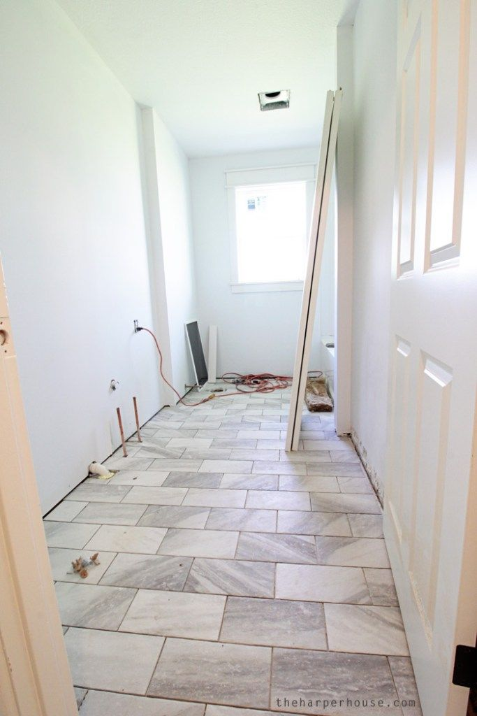 Love these new tile floors in the hall bath at the Flip House, and they're only $2.86/sq ft! Find out where to buy them on the blog   theharperhouse.com