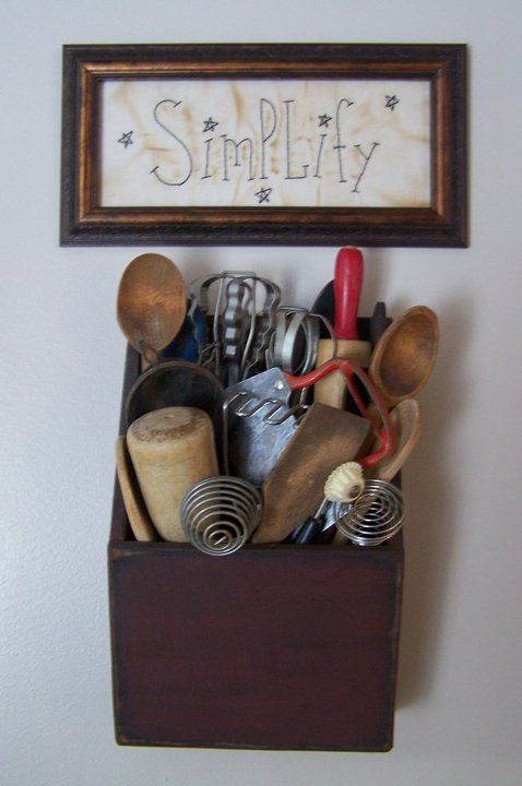 Love this wall hanging kitchen utensil holder! Looks like it may have been a letter holder at one time. Great reuse! Love the pic, too!