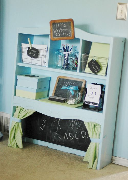 What a cute idea to repurpose and old shelf or hutch to make a little center for