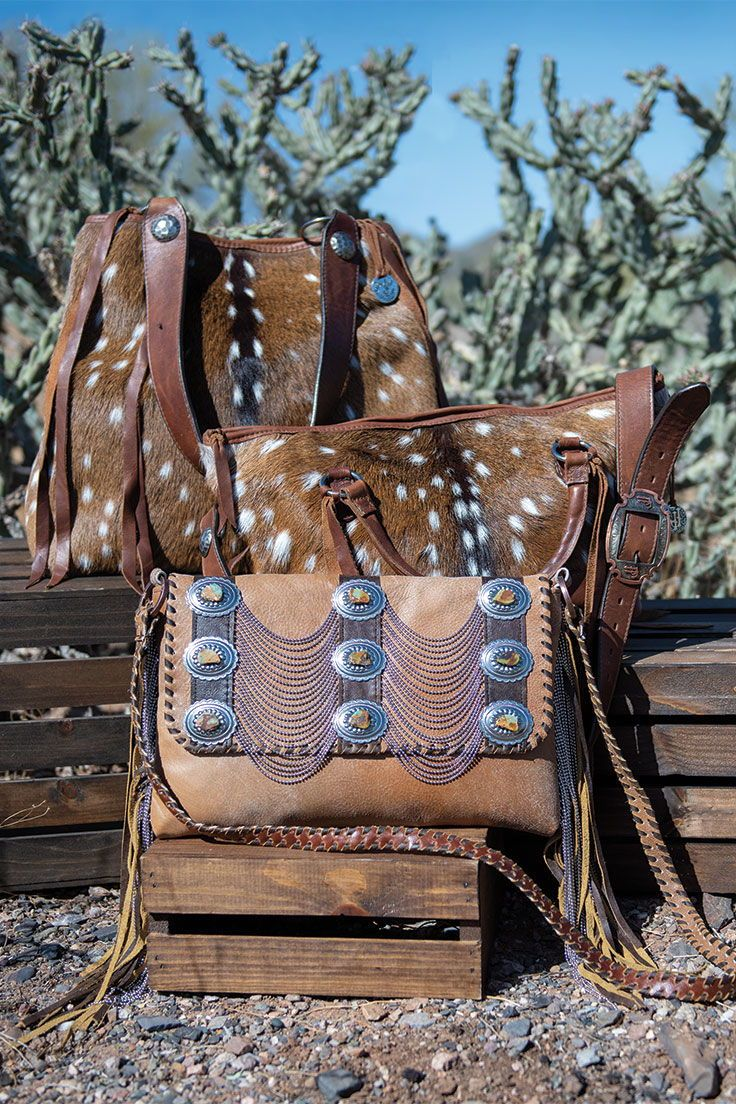 324cb6e33 Handy Bags Texture, fringe, and fuzz are all the rage when it comes to  handbag trends! #cowgirlmagazine #cowgirlstyle #cowgirlpurses  #leatherpurses # ...