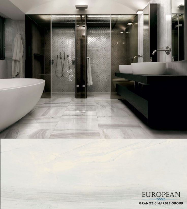 Introducing Florim - our new line of luxury porcelain tiles - featured on this magnificent bathroom floor in the design 'Bianchi Palissandro Polished'.  Florim tiles are available in a variety of sizes, from standard to extra large sizes up to 160x320 cm.  Find out more info here: http://www.egmcorp.com/florim/bianchi-palissandro-polished