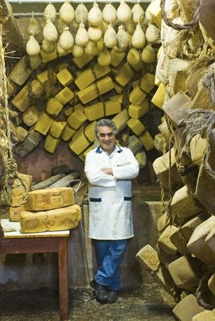 010561  Italy - Sicily -  Cheese monger Angelo di Pasquale in the cheese seasoning cellar, Ragusa