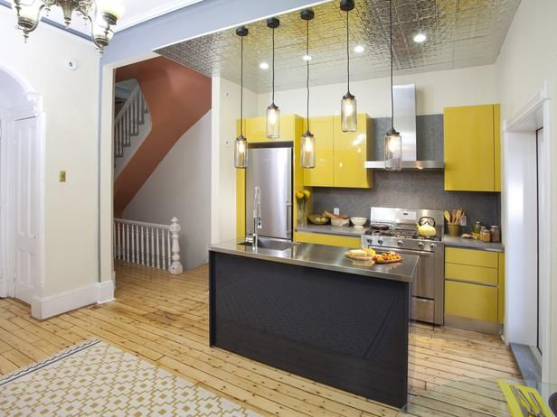 not crazy about the color but what a cute plan and love the tin ceiling over that small area - Small Kitchen Design Ideas and Inspiration on HGTV