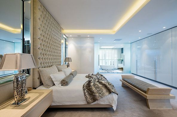 Clean lines and sophisticated finishes feature in the bedroom of the penthouse. #southafricanproperty