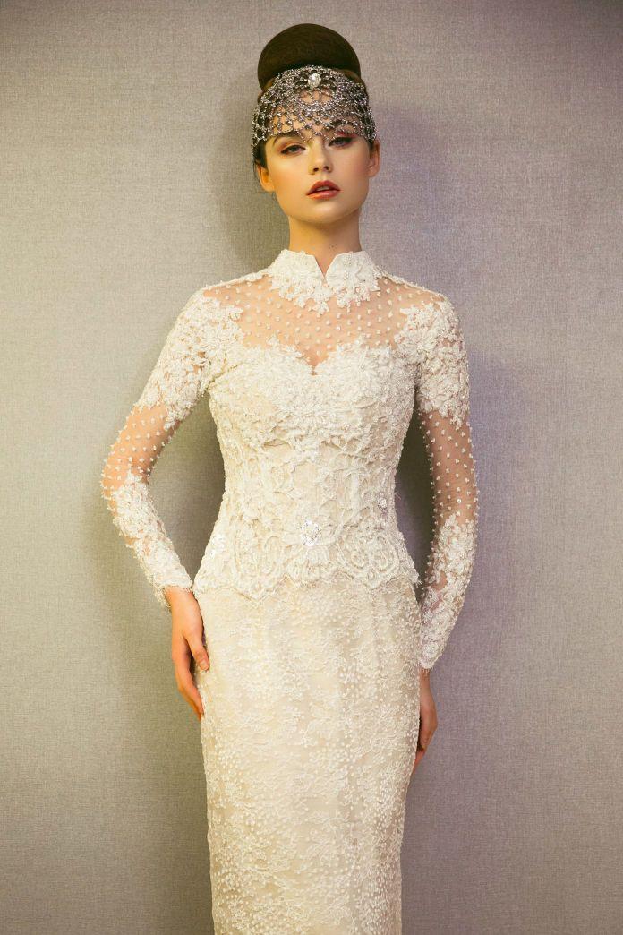 An inspiration for long sleeved wedding dress | http://www.bridestory.com/asky-febrianti/projects/wedding-gown-petal