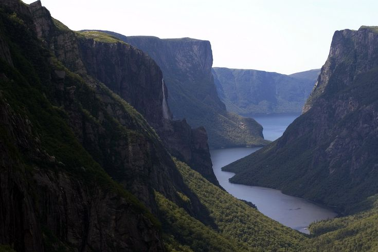 """Gros Morne National Park is a world heritage site located on the west coast of Newfoundland. At 1,805 km2 (697 sq mi), it is the second largest national park in Atlantic Canada (surpassed by Torngat Mountains National Park at 9,600 km2/3,700 sq mi). The park takes its name from Newfoundland's second-highest mountain peak (at 2,644 ft/806 m) located within the park. Its French meaning is """"large mountain standing alone,"""" or more literally """"great sombre."""" Gros M..."""