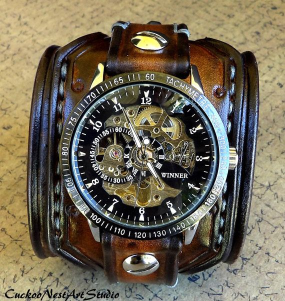 Mens aged brown color watch cuff made with veg tanned leather, completely handmade, hand tooled, hand stitched with natural thread. The