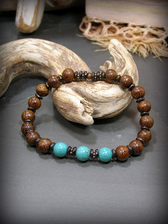 A dark earthy men's bracelet beaded in turquoise magnesite stones and dark rich Madre de Cacao Wood. Chocolate colored bone spacer beads separate with copper wheels added between the turquoise.  A great southwest rustic style for men.  By Stoneweardesigns