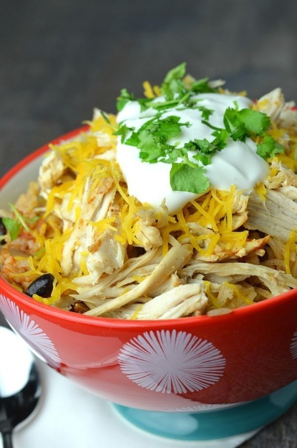 My family loves these Instant Pot Chicken Taco Bowls. Just a few minutes to prep and half an hour to cook. So easy and delicious!