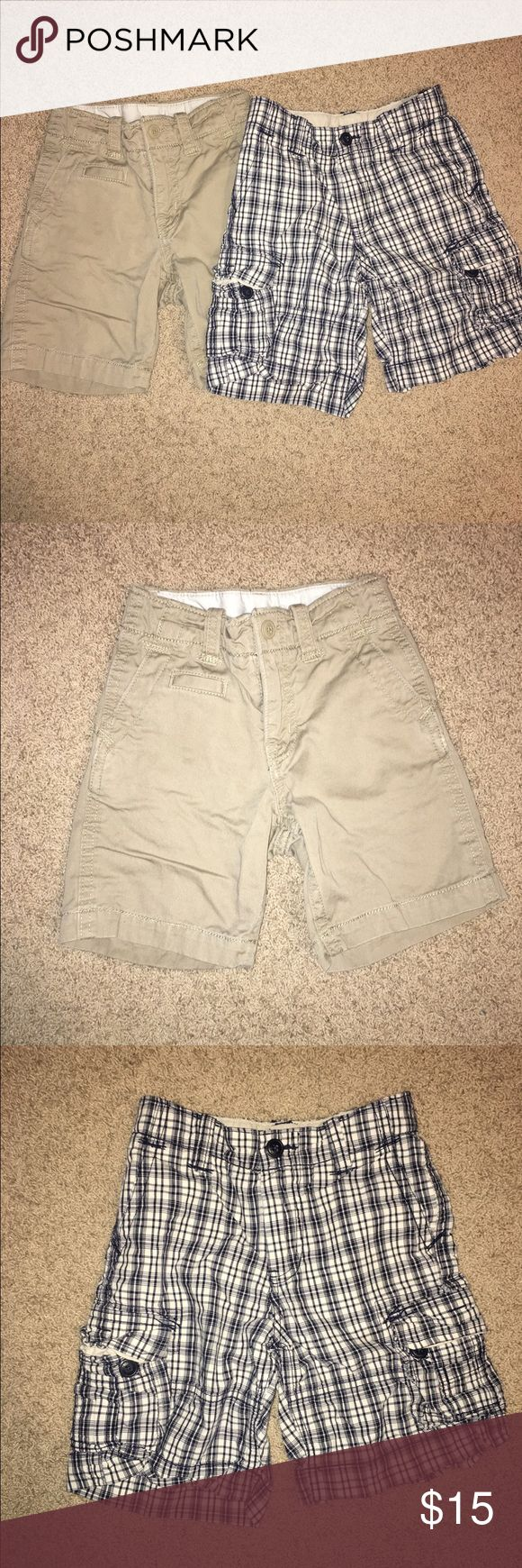 2 pair of Gap Kids boy's shorts Excellent condition!  Two pair of boys chino shorts.  One pair is true khaki, the other a cream/ blue plaid.  Adjustable waist on both although the buttons are missing on the inside waist of the plaid pair. GAP Bottoms Shorts