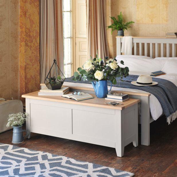 Grey bedroom furniture, bed, blanket box, flowers, blue vases, vintage wallpaper, antique curtains