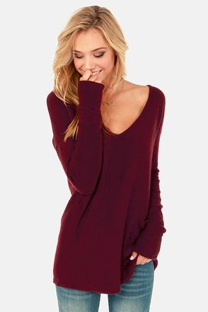 Are you ready for this? You'll be blown away by the unbelievably soft Ready or Knit Burgundy Sweater! Treat yourself to this indulgent burgundy knit, with long sleeves and a wide-cut bodice for extra cozy appeal. A V-neck keeps it chic, while asymmetrical seams spice up each side. Unlined. Model is wearing a size small. 55% Nylon, 30% Wool, 15% Angora. Hand Wash Cold, or Dry Clean. Imported.