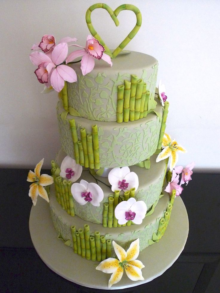 Beautiful simple 4 tier tropical wedding cake with orchids, lilies, and bamboo perfect for a beach wedding!