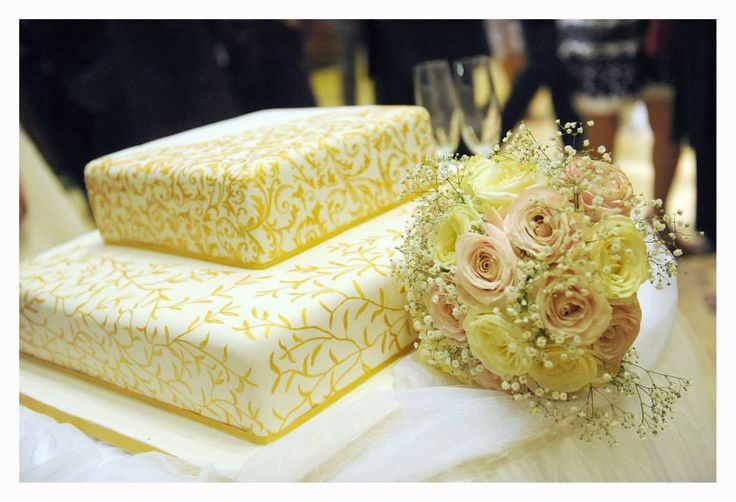 Hand painted wedding cake in gold.