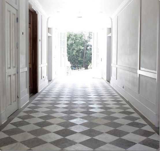 hallway with white grey checkered tile vs black and white yes i