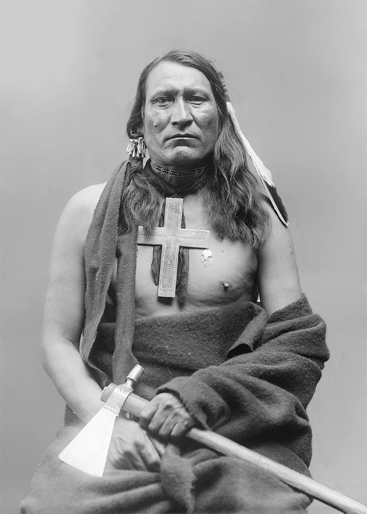 Cheyenne. That's quite a large cross. Was he forced to convert or did he do so willingly?