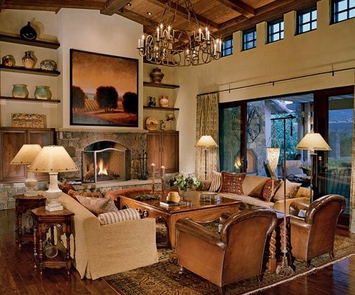 Ah. Warm colors, outside brought in, iron lighting, stone, dark wood. Leather chairs! Pillows on couches. I should probably stop looking