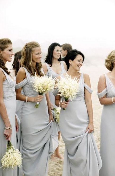Gorgeous long flowing bridesmaid dresses in a very pale blue