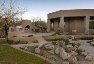Southwestern Landscape/Yard with outdoor pizza oven, Outdoor kitchen, Pathway, Fence, Eldorado Stone Stacked Stone - Santa Fe