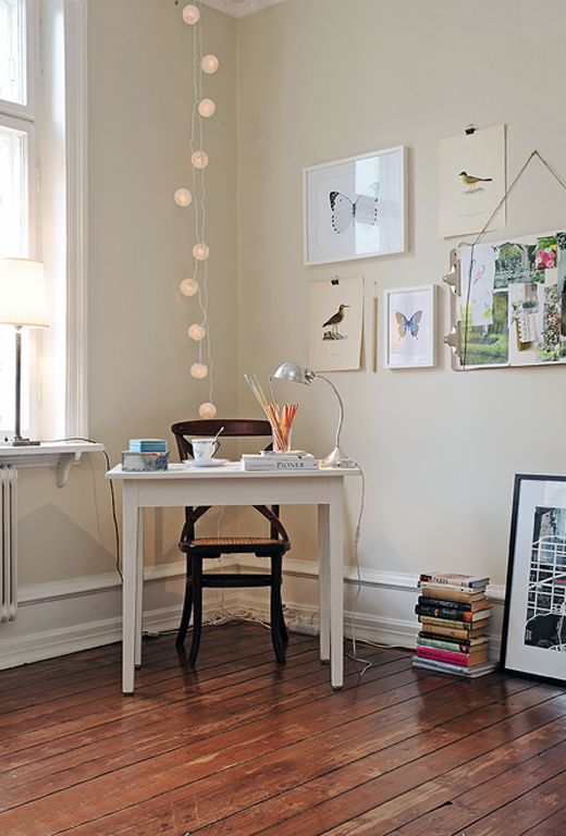 love the small work space, as well as the art wall with the office clips holding the bird-artwork. the hanging lights are a nice touch too!
