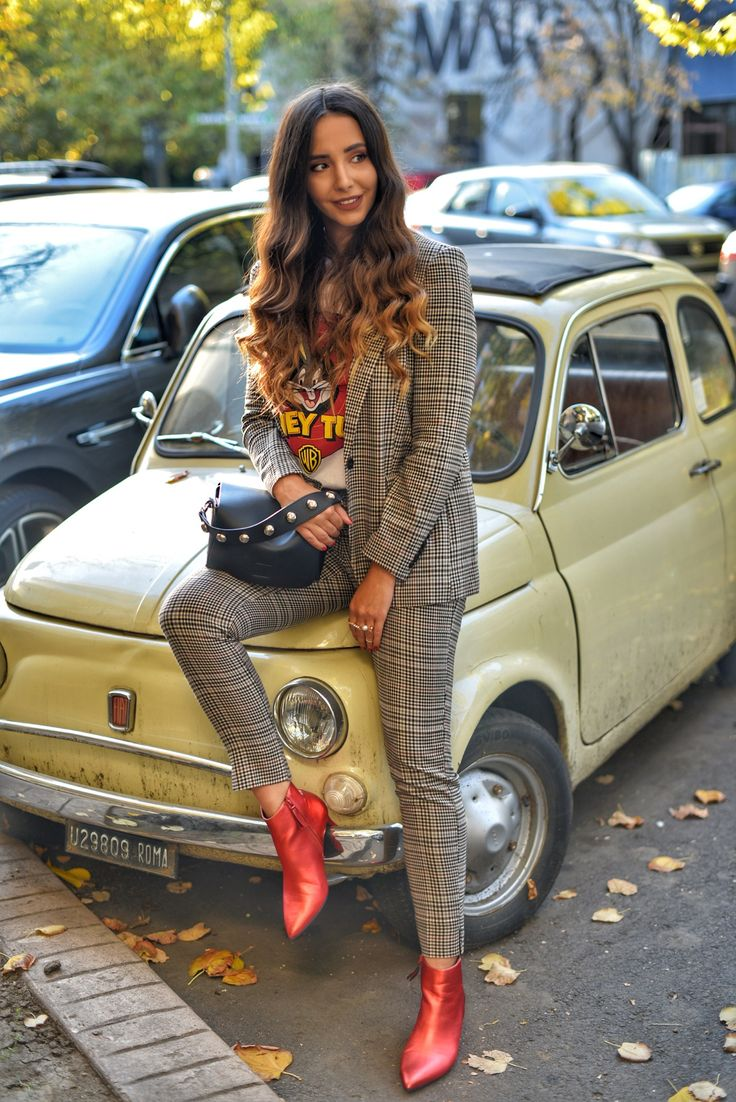 Modern ways to wear blazers: houndstooth suit with red boots and looney toons graphic tee