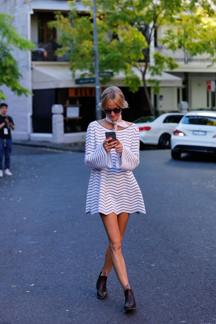 Nadia Fairfax wears flare sleeve zigzag stripe minidress with neck scarf and RM Williams boots