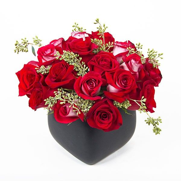 Eighteen red Roses touched up with seeded Eucalyptus in a black rounded ceramic pot. Send hand crafted flower arrangements and plants online this Valentine's. Colors of Love | Roses | Flower Delivery NYC Florist | Plantshed.com