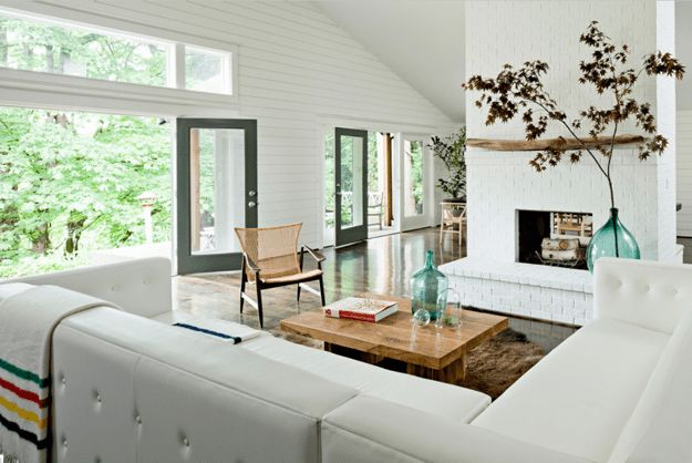 creamy white living room, white shiplap, white painted brick, dark wood floors, great view, mid-century modern interior, benjamin moore simply white