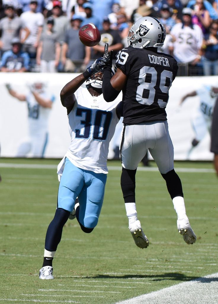 Jason McCourty #30 of the Tennessee Titans tries to defend Amari Cooper #89 of the Oakland Raiders during the first half at Nissan Stadium on September 25, 2016 in Nashville, Tennessee.  (Photo by Frederick Breedon/Getty Images)