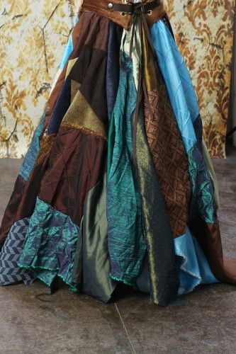 Full Length Patchwork Skirt in Blues and Browns. Love the leather vest too.  Might be the bottom half od a medieval costume?