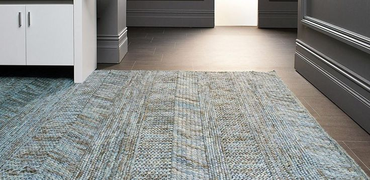 Hand-woven Wool and Viscose blend floor rug.