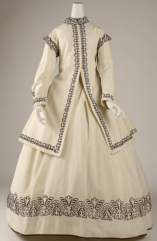 Dress (Met Museum)   Date: ca. 1865 Culture: British Medium: cotton, wool Dimensions: Length at CB (a): 42 3/4 in. (108.6 cm) Length at CB (b): 44 1/4 in. (112.4 cm) Credit Line: Purchase, Irene Lewisohn Bequest, 1985 Accession Number: 1985.23.1a, b