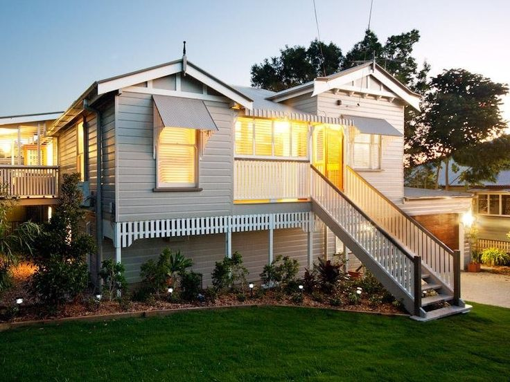 Weatherboard queenslander house exterior with porch & ground lighting - House Facade photo 489761