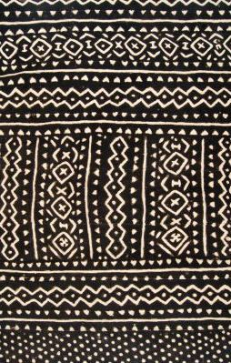 Africa | Detail from a piece of Mud cloth from the Bamana women of Mali | 20th century | Strip woven cotton with dense application of iron rich mud to the mordanted cotton cloth results in intricate negative pattern of exposed bleached area.