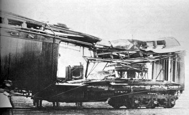 An express car blown to pieces during the train robbery committed by Cassidy and other bandits at Wilcox, Wyoming, June 2, 1899; the guard, a defiant man named Woodcock, was almost killed when Butch set off the dynamite, which had been placed at the door of the car.