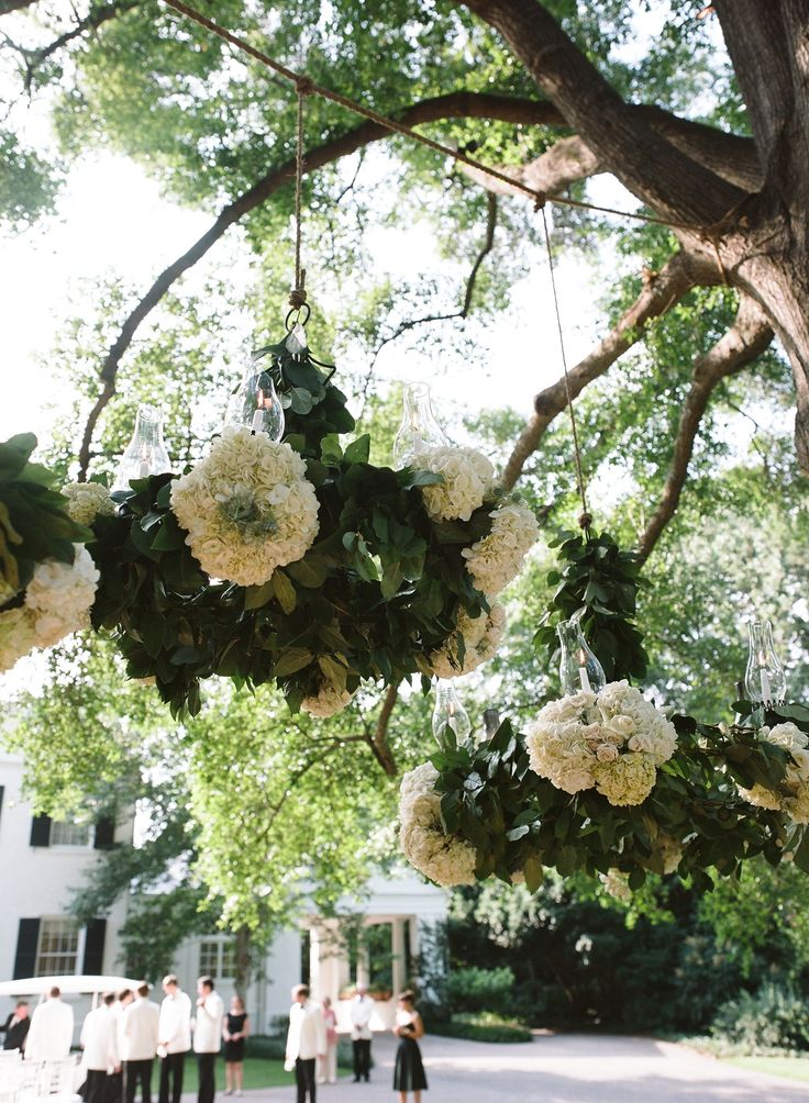 Hanging Floral Chandelier --  See More Here: http://www.stylemepretty.com/southeast-weddings/2014/04/11/classic-southern-wedding-at-home/ Photography: LizBanfield.com