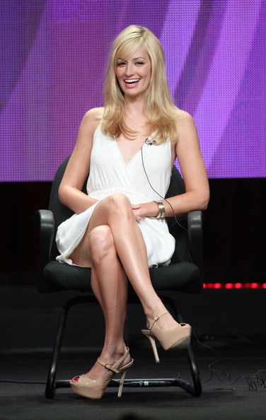 Beth Behrs Photos Photos - Actress Beth Behrs speaks during the '2 Broke Girls' panel during the CBS portion of the 2011 Summer TCA Tour held at the Beverly Hilton Hotel on August 3, 2011 in Beverly Hills, California. - 2011 Summer TCA Tour - Day 8