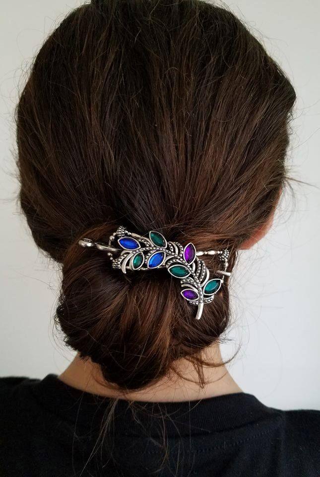 Stunning Jewel Toned Hair Clip In A Drop Bun Hairstyle Beautiful