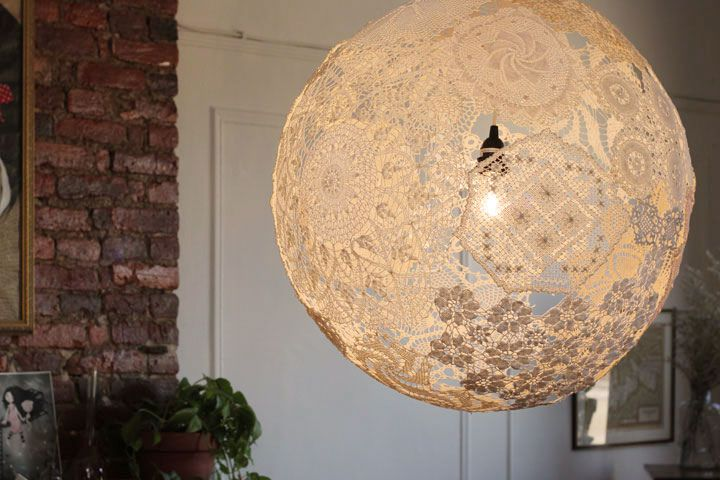 gorgeous doily light fixture// i think a bunch of little ones on twinkle lights would be adorable for a wedding