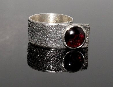 Reticulated silver ring with garnet cabochon gemstone