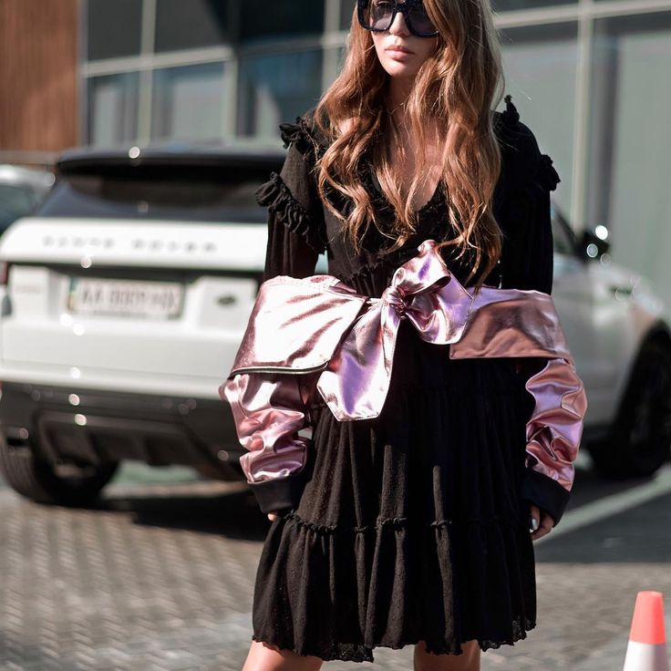 """Our designer Anna Sokol wearing WeAnnaBe black dress with frills. Delicate frills play out across the relaxed design with long sleeves and keyhole tie front. Wear yours with eco-leather jacket, boots or sneakers. Check out our street style ideas and chic looks! Click """"Visit"""" to buy it now. Fall 2017. Fashion 2017."""