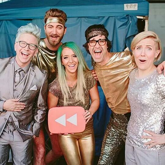 It's the guys from good mythical morning, Tyler Oakley, Hannah hart, and Jenna marbles. The whole crew wearing silver and gold.