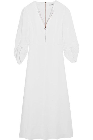 RUCHED DETAILS: Tibi's 'Marta' dress will work for a host of warm-weather occasions. Made from ivory linen-blend, this midi piece has ruched sleeves and a smooth cotton lining for coverage. Mirror the brand styling with slides, leaving the front zip half undone to enhance its relaxed feel.