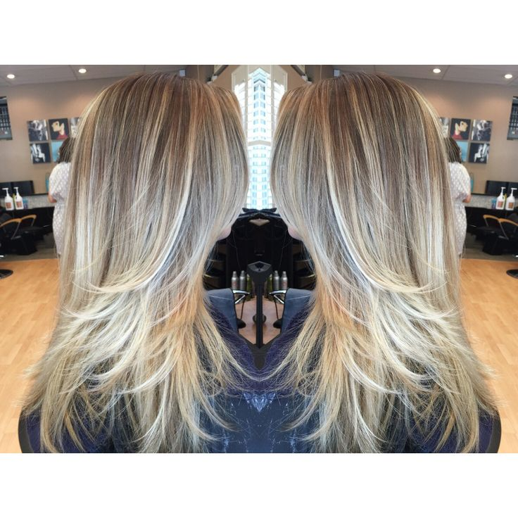 Balayage ombre blonde long hair and a pearly ash tone